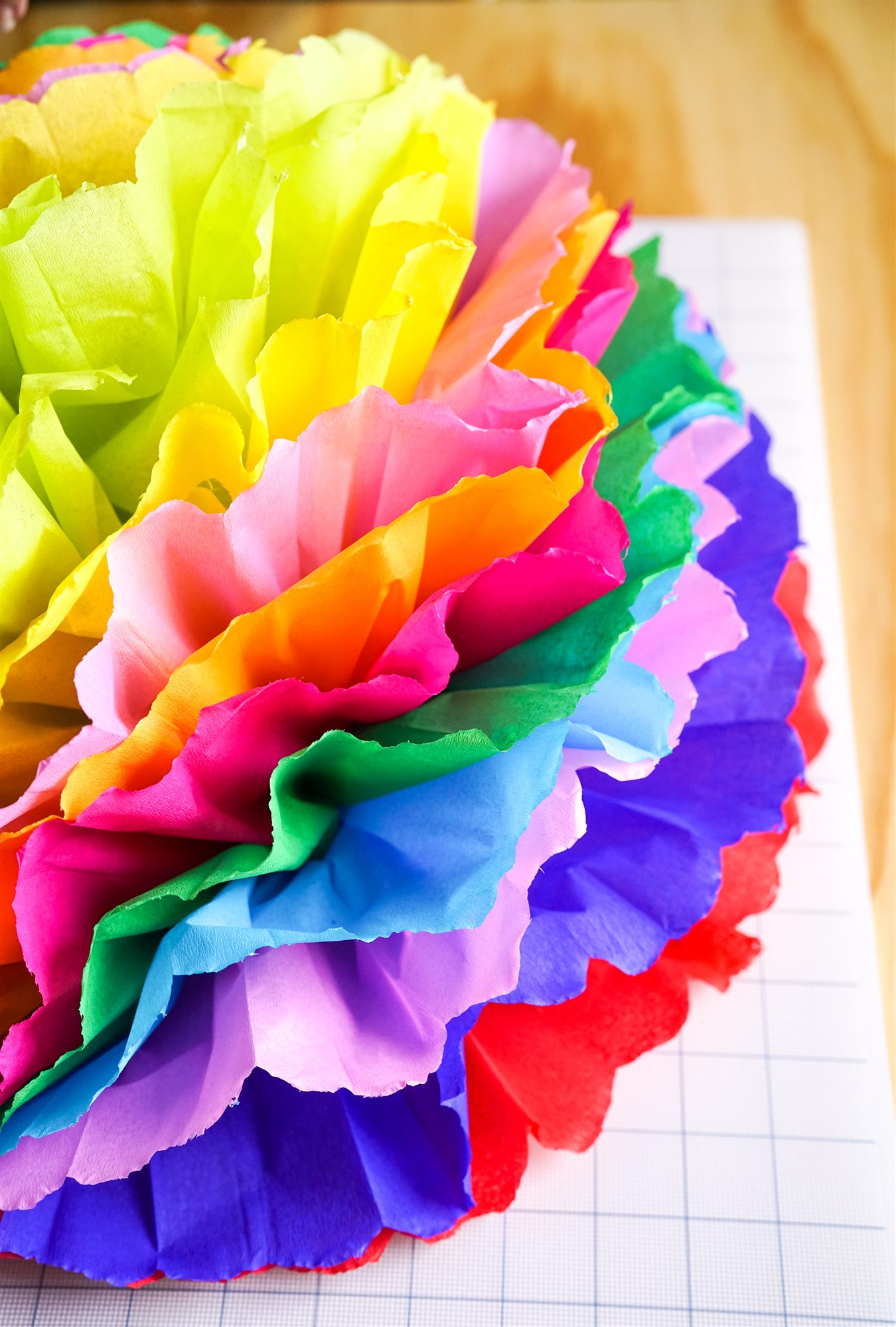 Fiesta flower tutorial make your own tissue paper flowers step 1 grab some sheets of tissue paper in your chosen colors for these we went bold and bright with 10 different colors to create this fiesta flower mightylinksfo